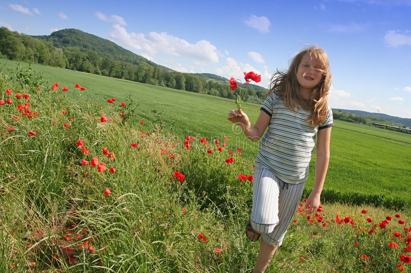 Happy girl on poppies field