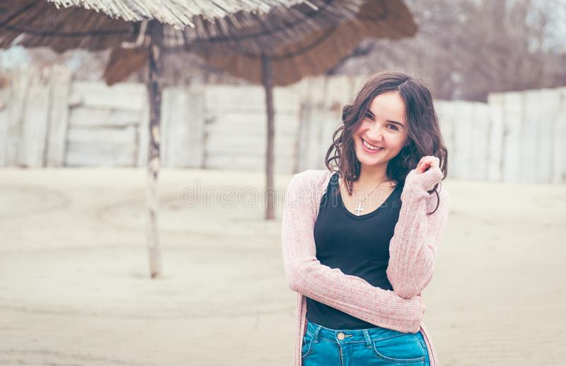 Portrait of beautiful positive happy sensitive young girl or woman posing outdoors in casual clothes with smile and adorable eyes royalty free stock images