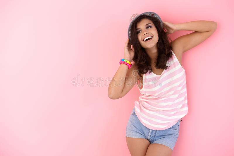 Happy girl posing in hat stock images