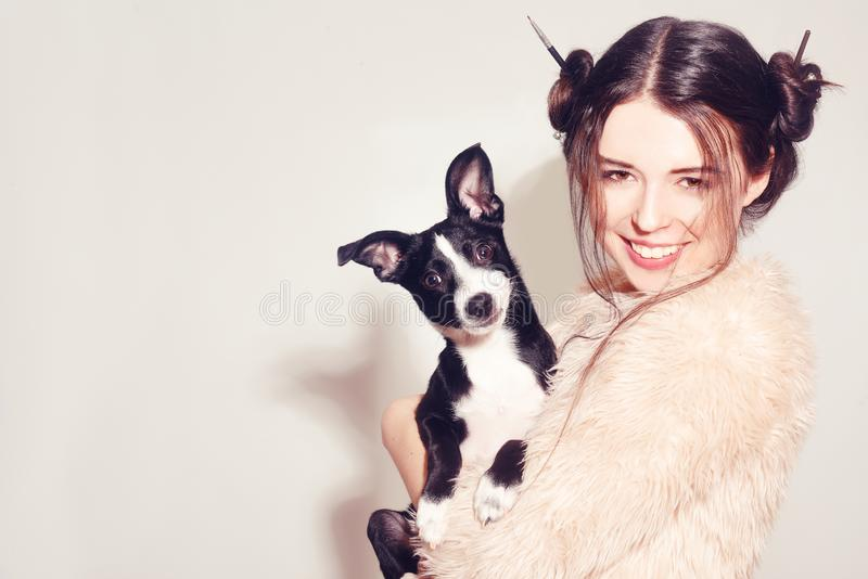 Happy girl with a puppy. Woman have fun with her dog. Dog owner having fun with pet. Friendship between human and dog. Pets stock photography