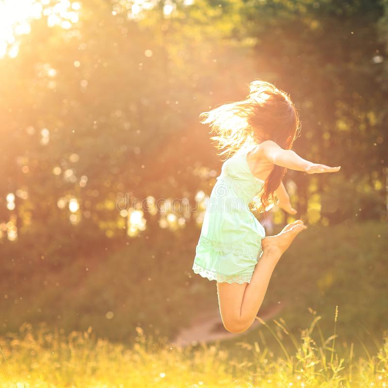 Happy girl in the rays of the setting sun. Happy girl in the rays the setting sun royalty free stock photos