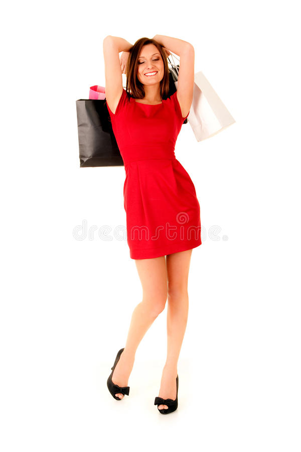 Happy girl in red dress royalty free stock photography