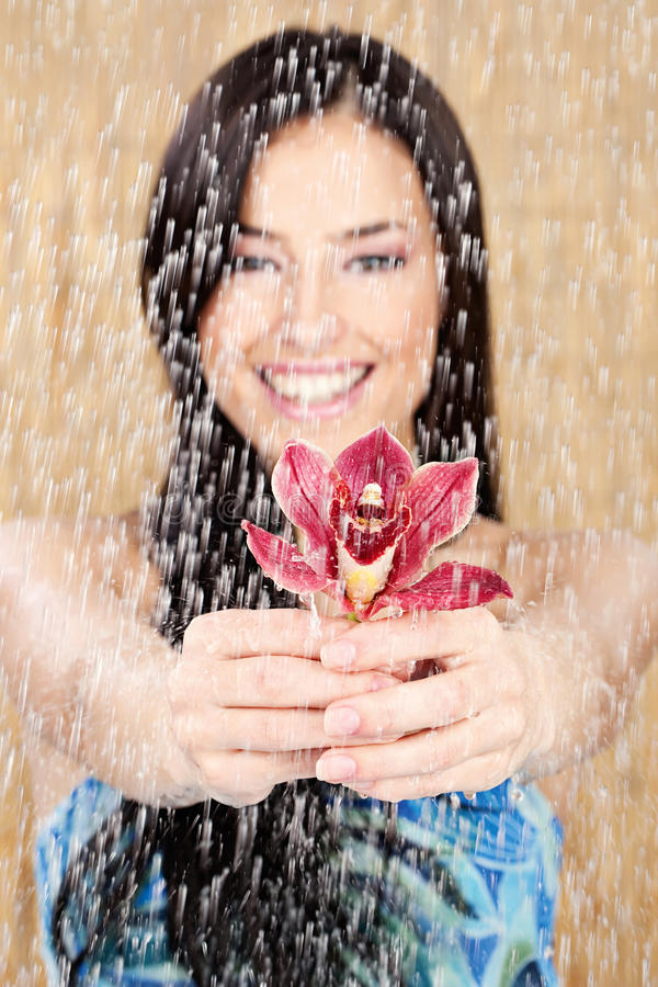 Happy Girl With Red Orchid Stock Photo