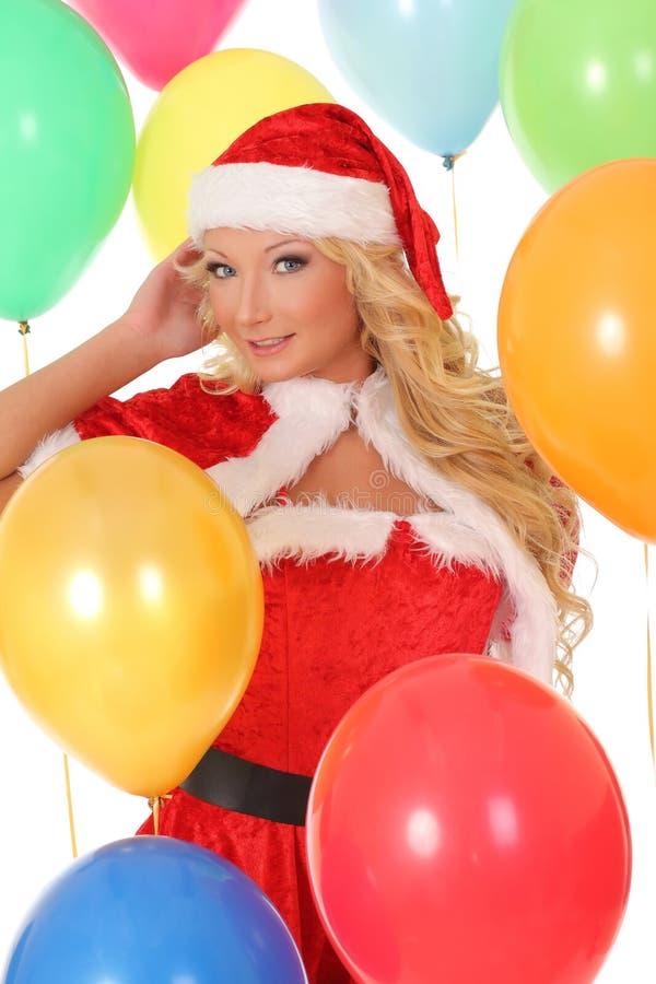 Happy girl in red Santa hat holding gift box stock image