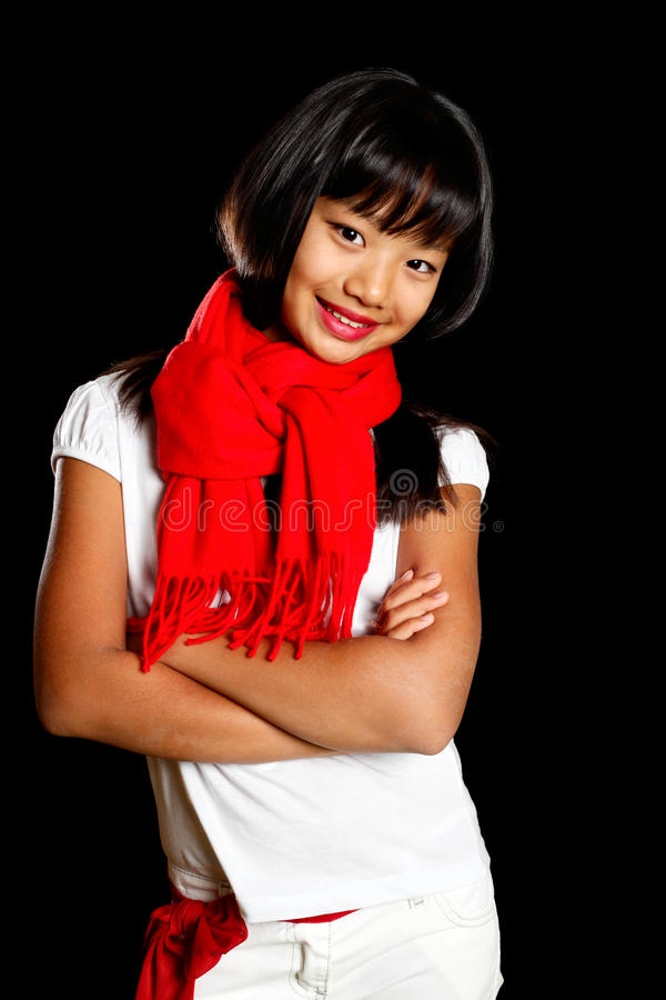 Happy girl in a red scarf royalty free stock image