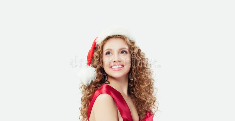 Happy girl in red swimsuit and Santa hat on white background, Christmas gift concept royalty free stock photo