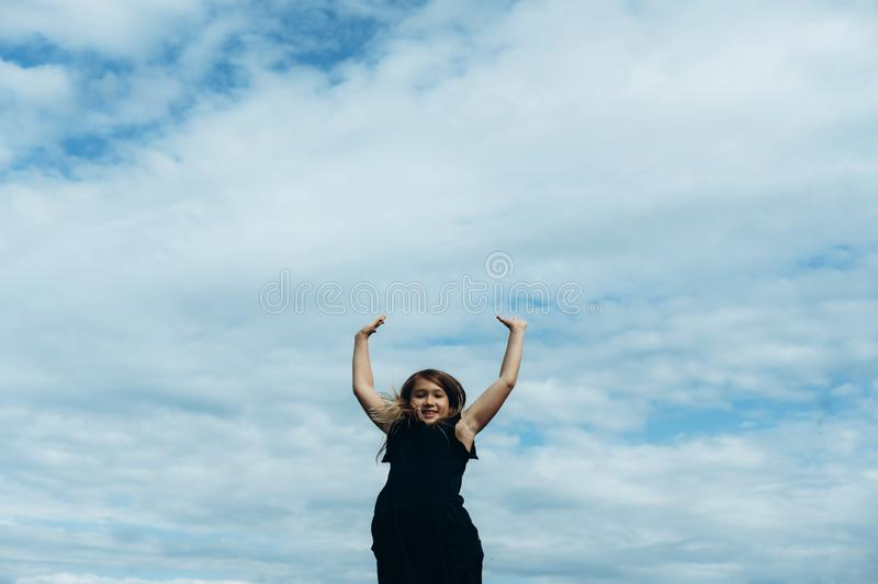 Happy girl rejoices summer royalty free stock photography