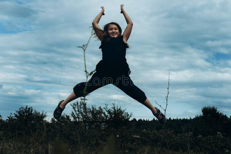 Happy girl rejoices summer royalty free stock image