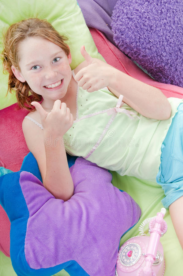 Happy girl relaxing. Young girl looking happy while relaxing royalty free stock image