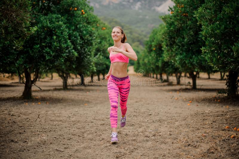 Happy girl running to the new life in the morning stock image