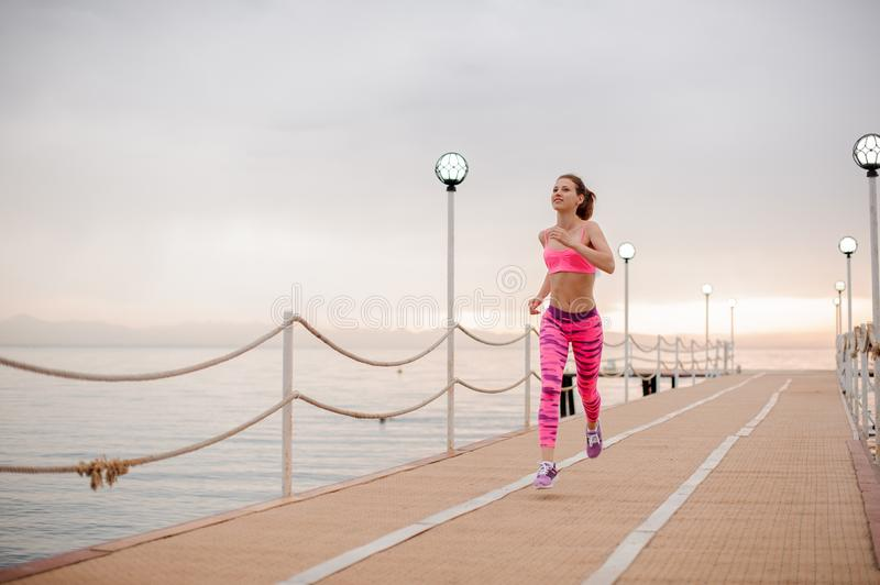Happy girl running to the new life on the sunrise royalty free stock photography