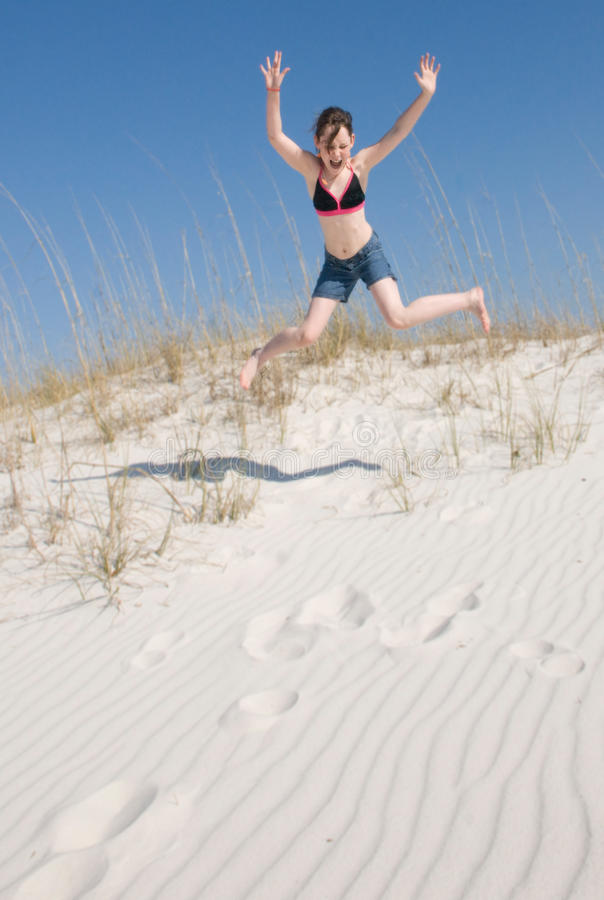 Download Happy girl on sand dune stock image. Image of weekend - 13853589