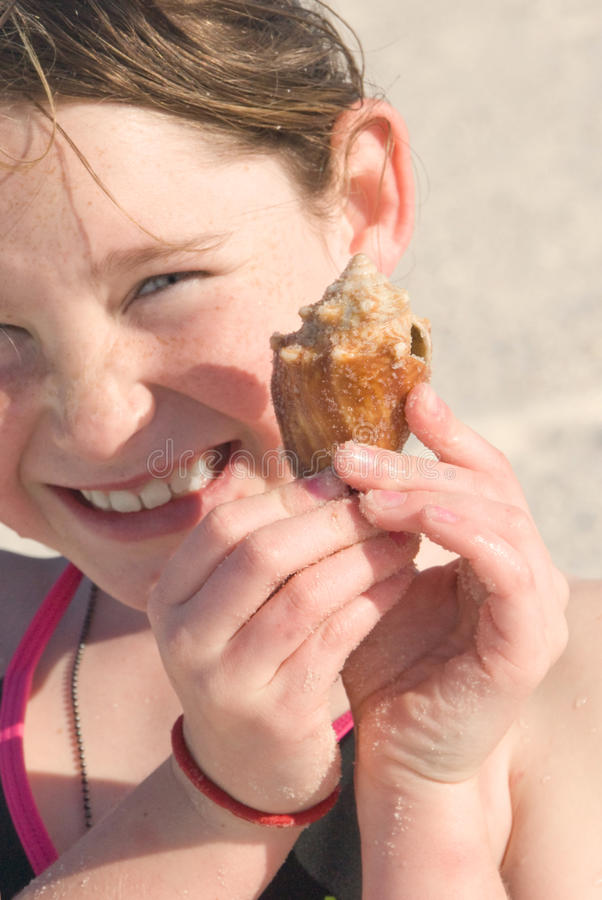 Download Happy girl with seashell stock image. Image of young - 13853595