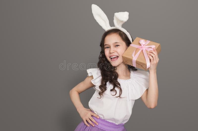 Happy girl shaking present to guess whats inside royalty free stock photography