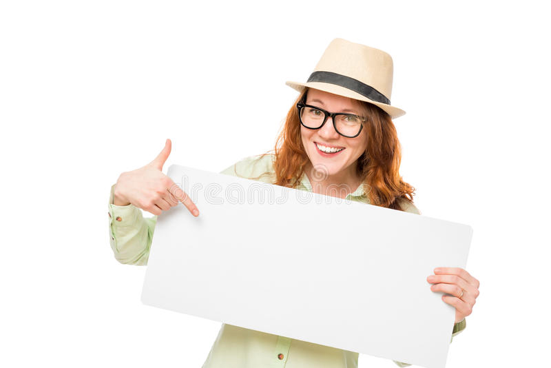 Happy girl showing on a blank poster. Isolated stock photos