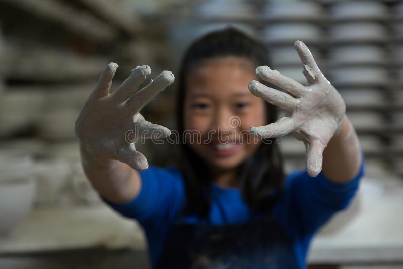Happy girl showing muddy hands stock images