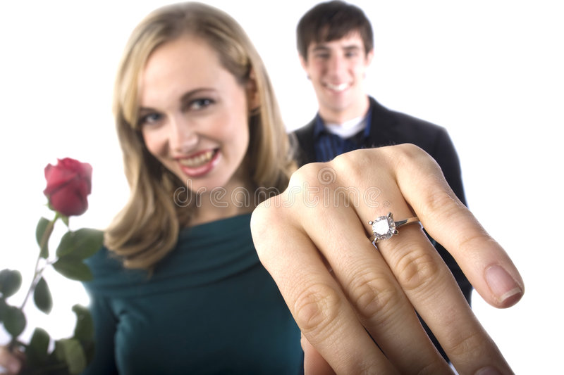 A happy girl shows off her new ring stock image