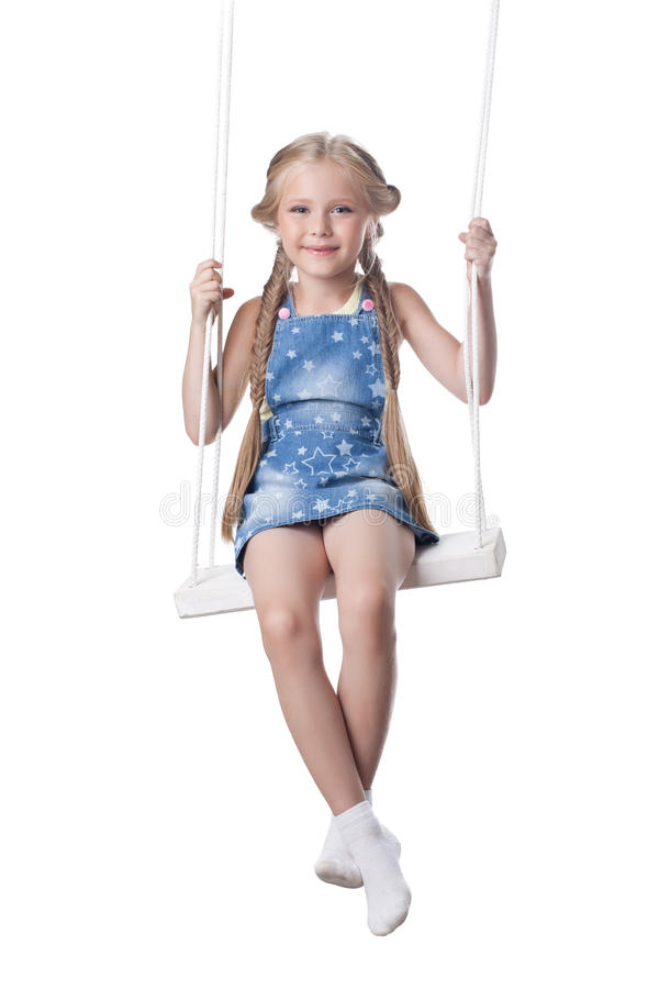 Happy girl sitting on swing royalty free stock image