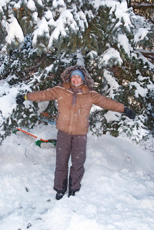 Happy girl in the snow forest stock photo