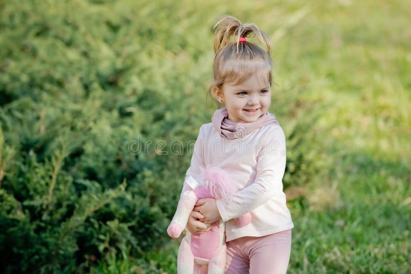 Happy girl with soft toy smile on natural background stock image