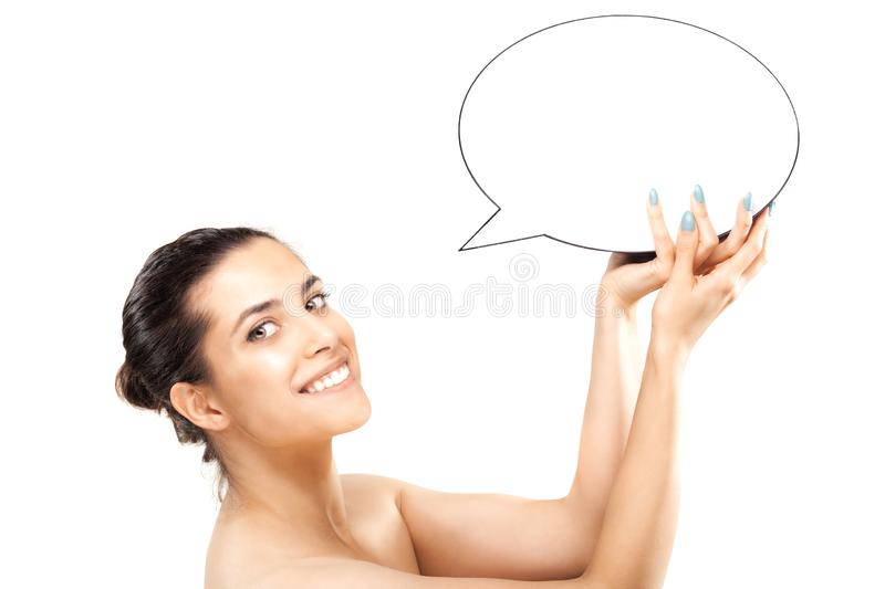 Happy girl with speech balloon. Happy girl holding an empty speech balloon bubble dialogue word comics thoughts lady isolated woman clean portrait hand health stock photos