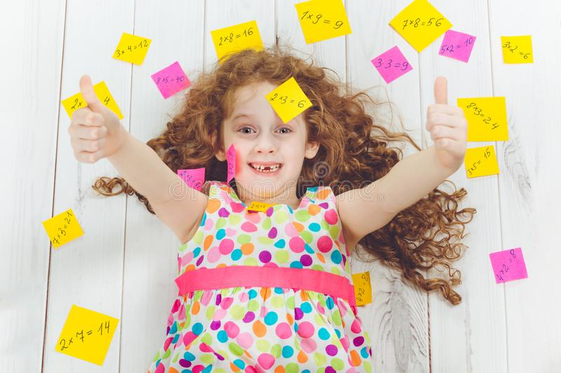 Happy girl with stickers on his head and around. Education concept. stock photos