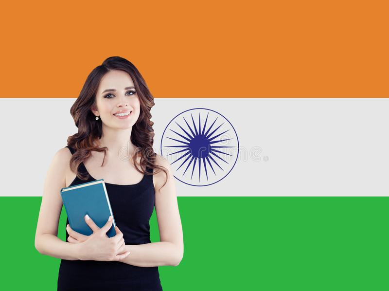 Happy girl student against the India flag background.  royalty free stock photography