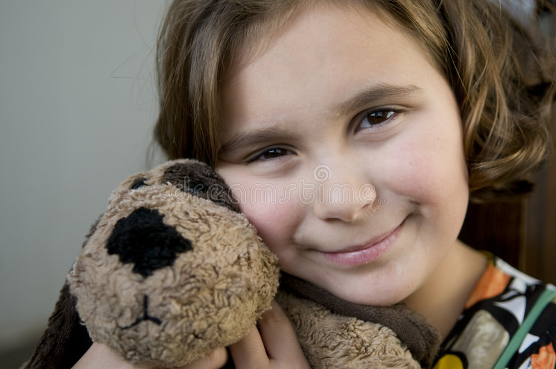 Download Happy Girl With Stuffed Dog Stock Image - Image: 7405227