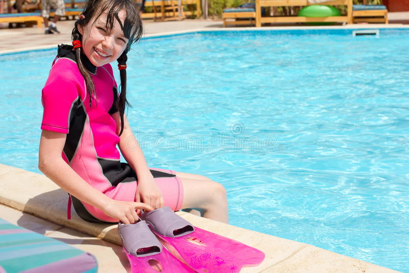 Download Happy Girl By Swimming Pool Stock Photo - Image of looks, seated: 20336504