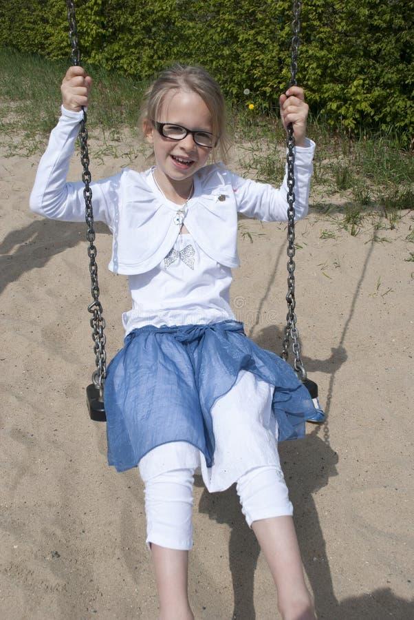 Happy girl on swing royalty free stock image