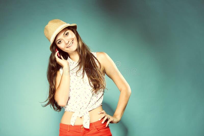 Happy girl talking mobile phone