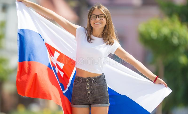 Happy girl tourist walking in the street with flag of slovak republic. Woman, slovakia, national, caucasian, young, female, beautiful, slovakian, people royalty free stock photo