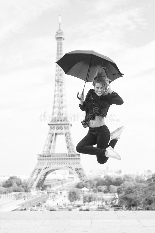 Happy girl travel in paris, france. Woman jump with fashion umbrella. Parisian on white background. Woman with royalty free stock image