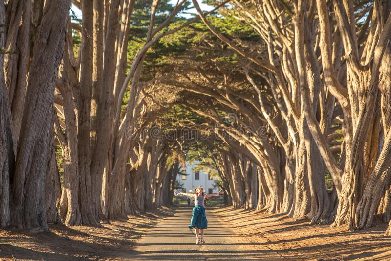 Happy girl in a tunnel with trees royalty free stock photos
