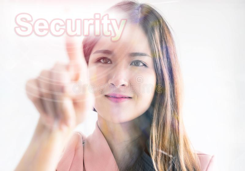 Girl using finger to touch the screen security stock images