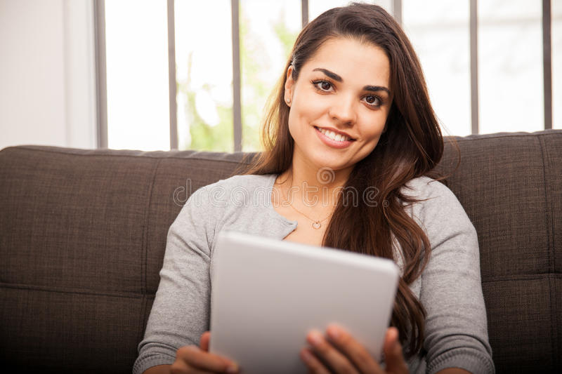 Happy girl using a tablet stock photos