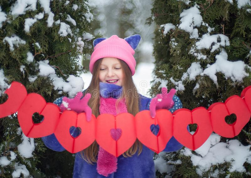 Happy girl with Valentine heart outdoor. Valentine`s day concept. Copy space. Card. royalty free stock images