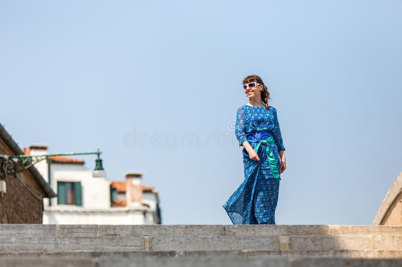 Happy girl on the walk in the street in Venice. Happiness, travelling, resting, vacation concepts. Happy smiling girl out on the walk on street in Venice stock photography