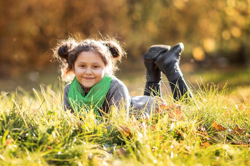 A happy girl is walking in the autumn forest stock photography