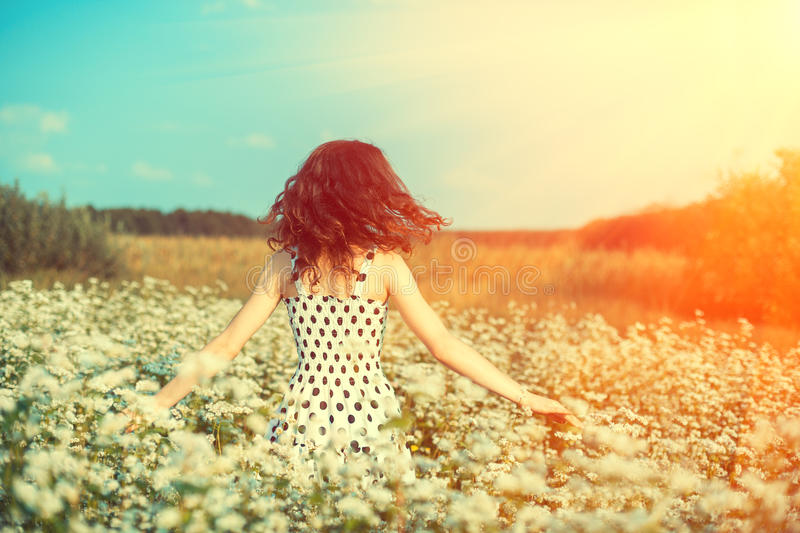 Happy girl walking on the buckwheat field stock photos