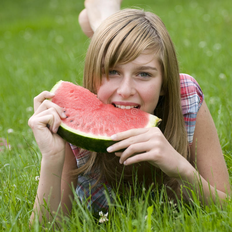 Happy girl with watermelon stock photo