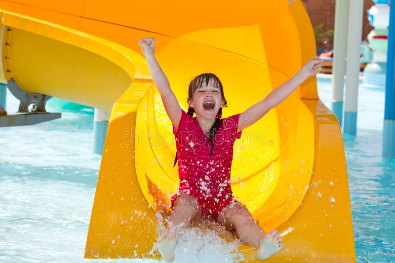 Happy girl on waterslide stock photo