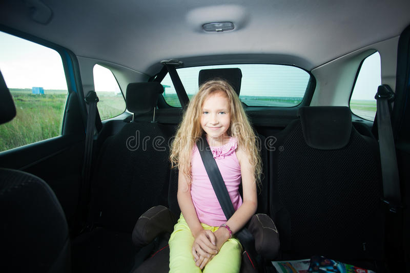 Happy girl wearing seatbelts royalty free stock images