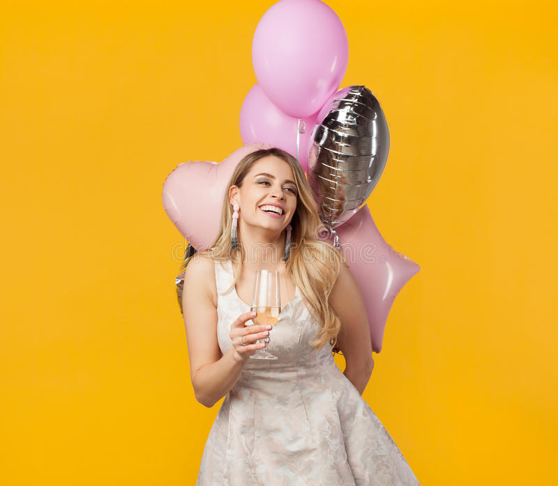 Happy girl with wineglass and balloons stock images