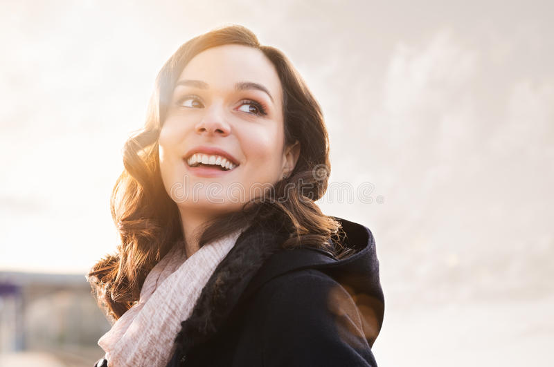 Happy girl in winter. Closeup of smiling thinking woman looking away outdoor royalty free stock photos