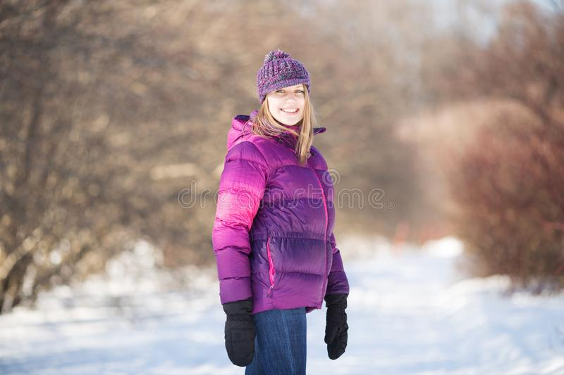 Happy girl in winter park stock images