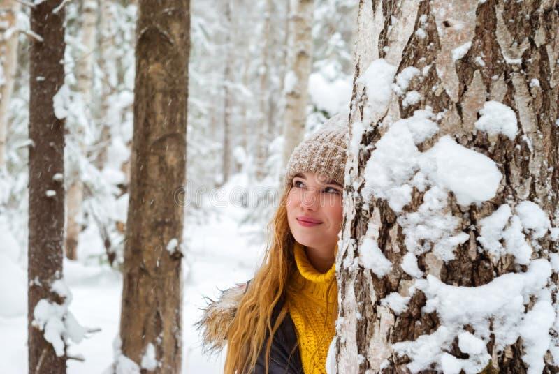 Happy girl in winter park royalty free stock photo