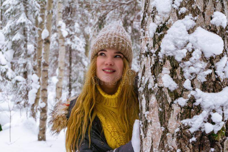 Happy girl in winter park royalty free stock photography