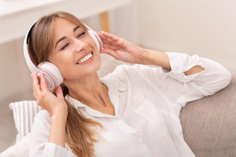 Happy Girl In Wireless Headphones Enjoying Music At Home stock photos