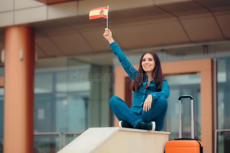 Travel Woman with Spain Flag ready to go on Spanish Vacation. Happy girl woman ready to visit Spain stock images